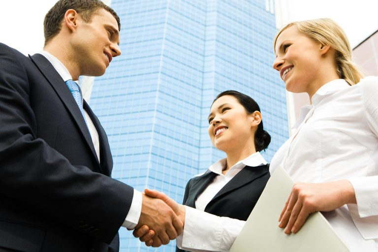 Woman shaking business associates hand