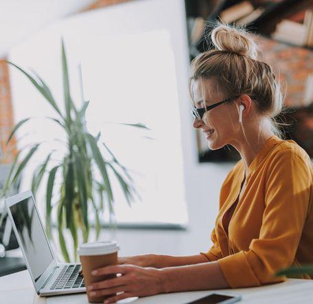 Entrepreneurial woman sitting at a computer